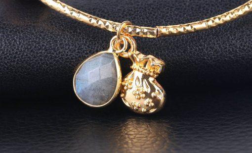Médaillon bourse et perle labradorite grise.jpeg