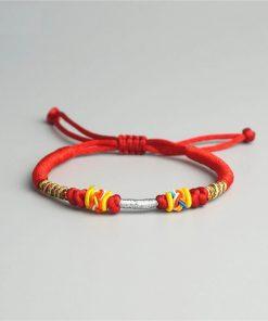 Bracelet porte bonheur tibétain tressé main rouge